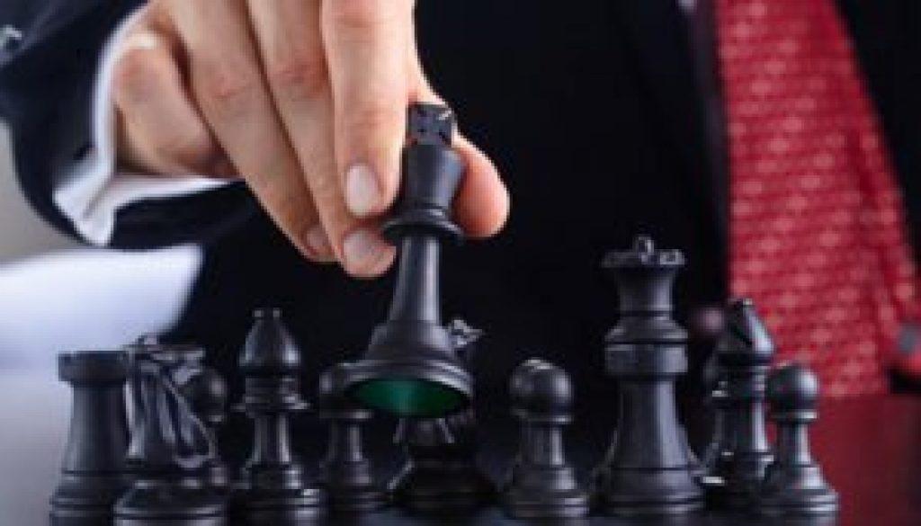 businessman-playing-chess-game-300x235.jpg