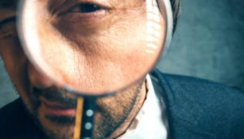 businessman-looking-through-magnifying-glass-300x235.jpg